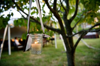 Mason jar hanging from tree