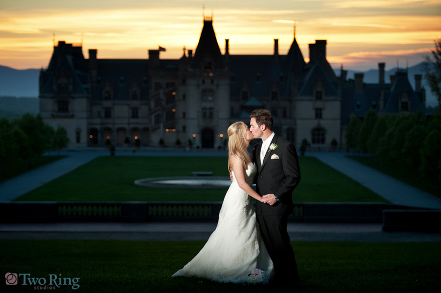 Portrait of bride and groom in front of Biltmore House