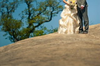 Portrait of bride and groom on rock