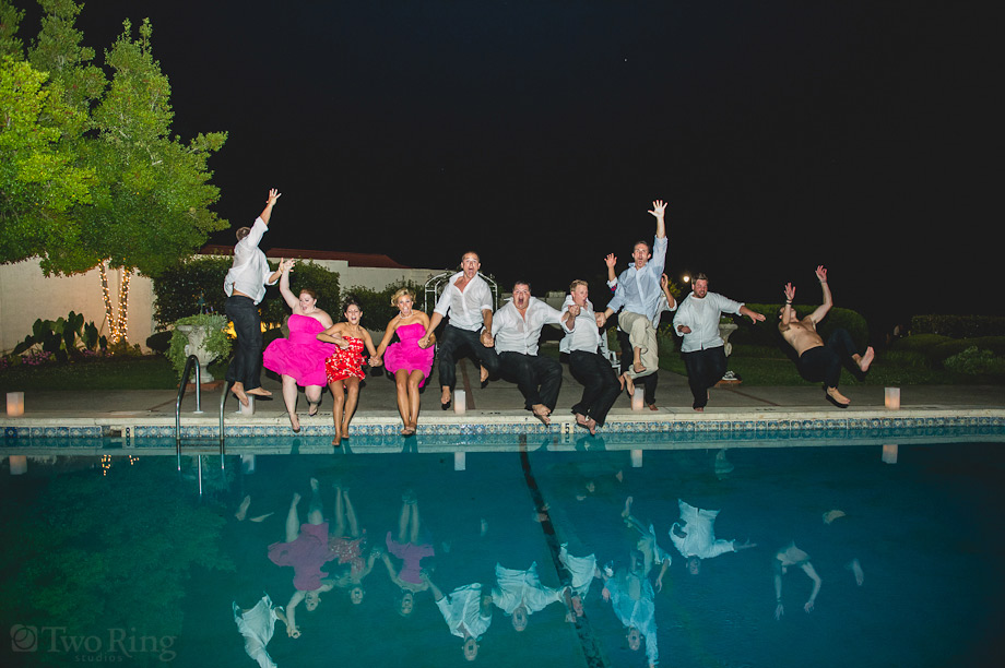 Bridal party jumping in pool