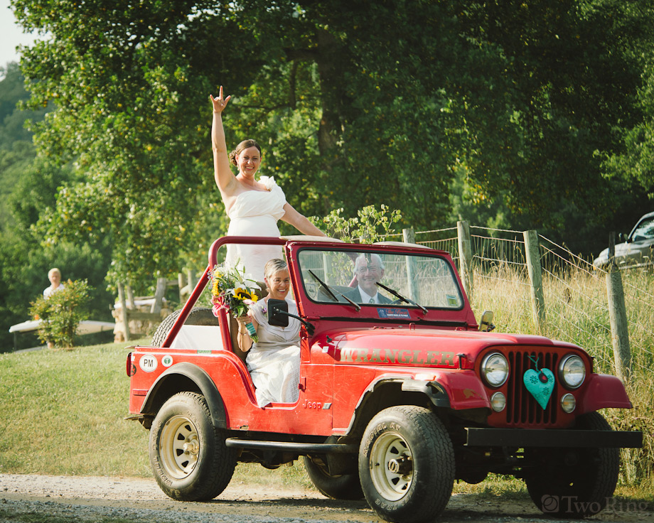 Bride being escorted in Jeep